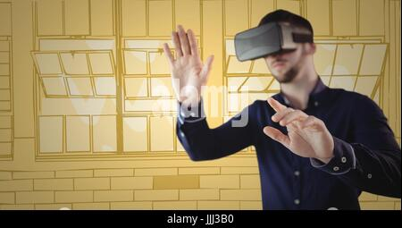 Man in virtual reality headset hands out against yellow hand drawn windows - Stock Photo
