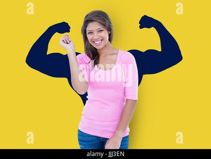 happy young woman in front of fists dark blue draw on yellow wall - Stock Photo