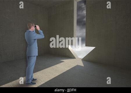 Man looking through binoculars against background with 3d arrow - Stock Photo