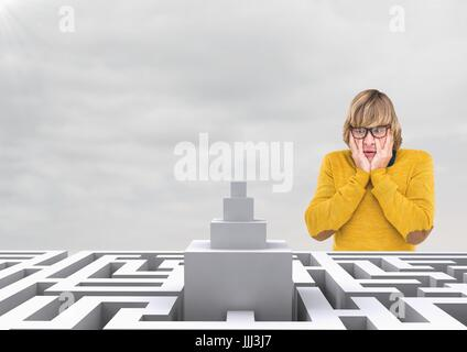 Confused man looking at a maze against a sky with clouds 3d - Stock Photo
