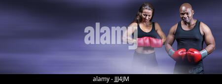 Boxer fighter man and woman with purple transition and copy space - Stock Photo