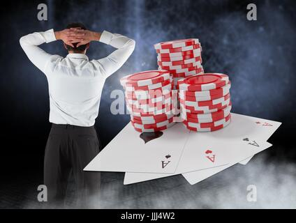 Back of Man with casino 3d poker chips and playing cards - Stock Photo