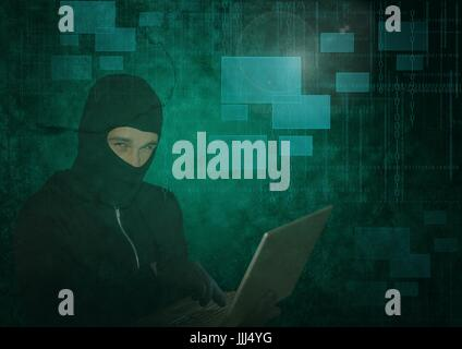 3d Hacker using a laptop in front of green digital background - Stock Photo