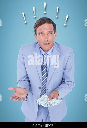 Frustrated business man with money against blue background and exclamation points - Stock Photo