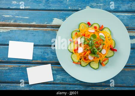 Bussiness cards on blue wooden desk with food 3d - Stock Photo