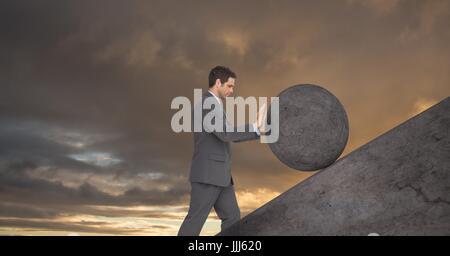 Man pushing 3D rolling round rock - Stock Photo