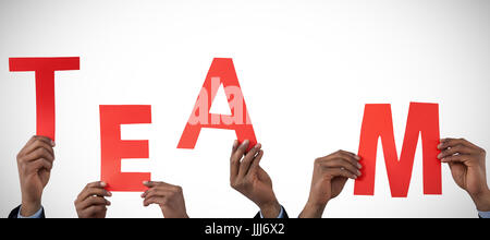Composite image of cropped hand of businessman holding alphabet a - Stock Photo