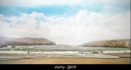 View of beach against cloudy sky - Stock Photo