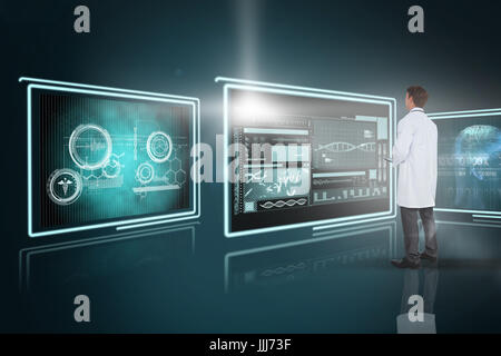 Composite 3d image of young doctor using tablet pc - Stock Photo