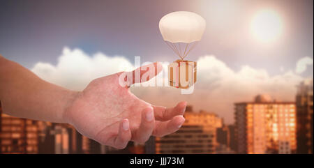 Composite 3d image of hand of man pretending to hold an invisible object - Stock Photo