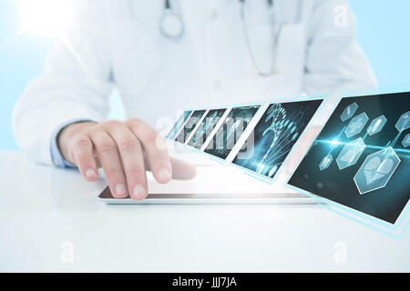 Composite 3d image of doctor using digital tablet against white background - Stock Photo