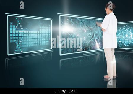 Composite 3d image of pretty nurse using tablet pc - Stock Photo