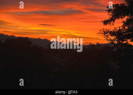 Sunrise clouds and mountains in Guatemala, dramatic sky with striking colors. La Reunion. - Stock Photo