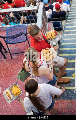 Washington, DC - Baseball fans carry food from a concessions stand at Nationals Park. - Stock Photo