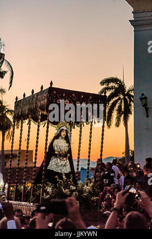 During EASTER known as SEMANA SANTA religious statues are paraded through town at dusk - TRINIDAD, CUBA - Stock Photo