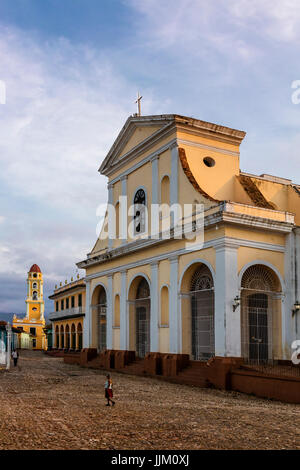 The IGLESIA PARROQUIAL DE LA SANTISIMA TRINIDAD is located on PLAZA MAYOR - TRINIDAD, CUBA - Stock Photo