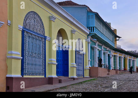 The cobble stone streets, wrought iron work and colorful houses of TRINIDAD, CUBA - Stock Photo