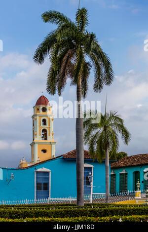 The bell tower of the  MUSEO NACIONAL DE LA LUCHA CONTRA BANDIDOS from the PLAZA MAYOR - TRINIDAD, CUBA - Stock Photo