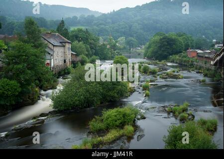 River Dee flowing through town of Llangollen. Wales, UK - Stock Photo