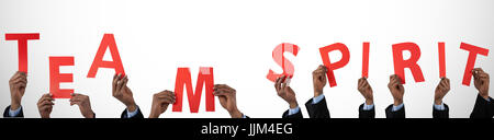 Composite image of cropped hand of businessman holding alphabet e - Stock Photo
