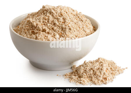 Spelt whole grain flour  in white ceramic bowl isolated on white. Spilled flour. - Stock Photo