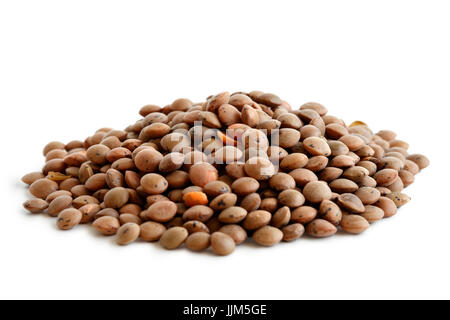 Heap of unpeeled red lentils isolated on white. - Stock Photo