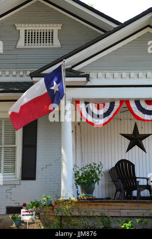 The Texas Flag Flys From Front Porch Of An Arts And Crafts Home In