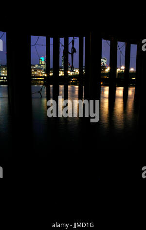 Looking across the River Thames from Bankside at dusk to Tower 42, City of London, UK - Stock Photo