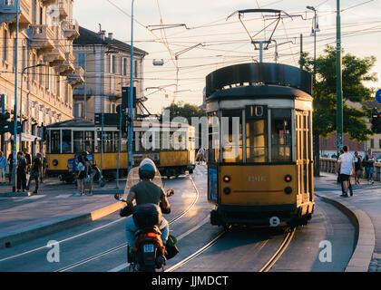 Traditional yellow tram near city centre, Milan, Lombardy, Italy - Stock Photo