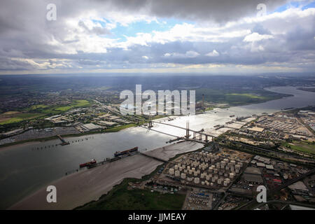 An aerial view showing the QE2 Bridge over the River Thames at Thurrock illuminated by sunlight - Stock Photo