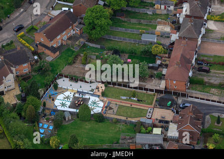 An aerial view of typical suburban back gardens - Stock Photo