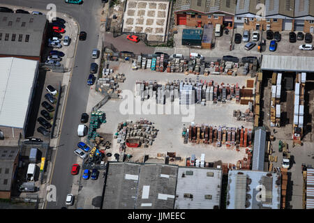 An aerial view of building materials being stored outside at a Builders Merchants - Stock Photo