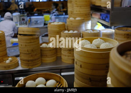 Preparing Dim Sum in a Chines Malaysian restaurant, the dumplings are freshly prepared and cooked to order. - Stock Photo