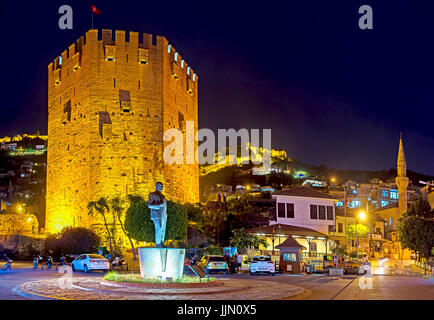 The night cityscape of Alanya, the Red Tower (Kizil Kule) and ramparts of the Citadel are brightly illuminated, - Stock Photo