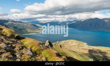 View of lake in mountain landscape, rugged landscape, Lake Hawea, Otago, South Island, New Zealand - Stock Photo