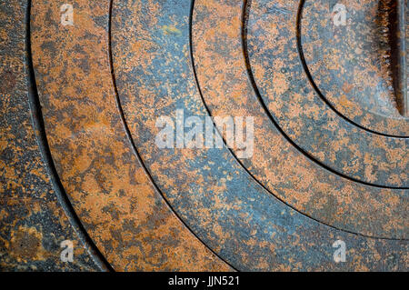 abstract metal background with geometric holes in a circle and texture rust orange-brown with spots. The horizontal - Stock Photo