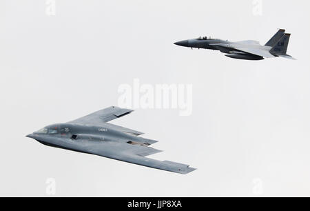 northrop grumman b-2 stealth bomber with f-15 eagle - Stock Photo