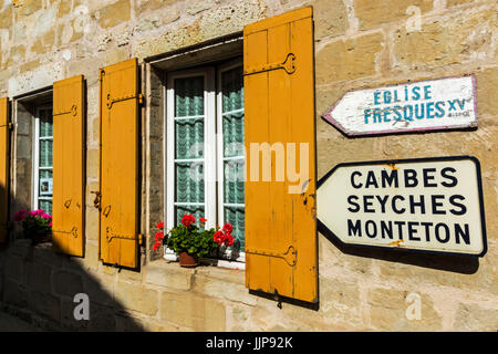 Shuttered window & signs in this old village on the Dropt River near Duras; Allemans-du-Dropt; Lot-et-Garonne; Aquitaine, - Stock Photo