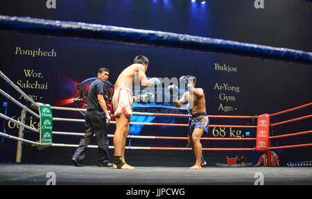 Muay Thai boxers in action, Bangkok, Thailand - Stock Photo