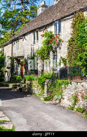 A lane of pretty terraced stone cottages in the Cotswold village of Castle Combe in Wiltshire. - Stock Photo
