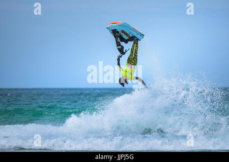 British jetski star Dan Foy competes in the IFWA Championships at Fistral beach in Cornwall. - Stock Photo