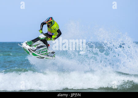 A jetskier competes in the IFWA Championships at Fistral beach in Cornwall. - Stock Photo