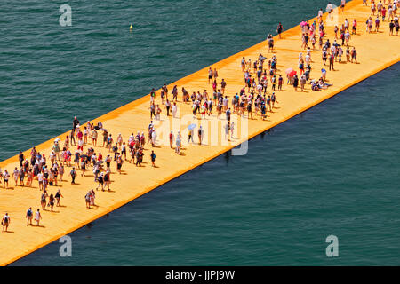 View from above of crowds of people on the Floating Piers Project for Lake Iseo which is an artwork by Christo and - Stock Photo