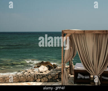 Spa treatment on the cretan beach - Stock Photo