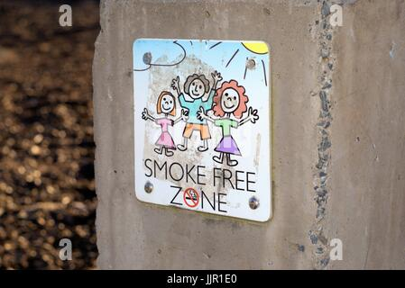 Dated 20 July 2017. Illustrative editorial use. Sign 'Smoke free zone' on wall at a public park Coffs Harbour, New - Stock Photo