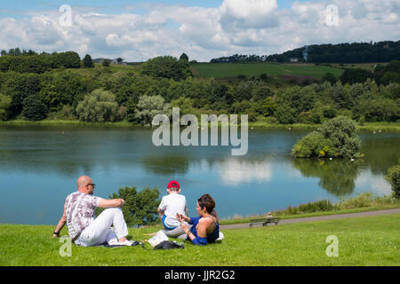 Family having picnic beside Linlithgow Loch at  Linlithgow Palace in Scotland, United Kingdom - Stock Photo
