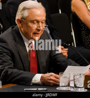 US. Attorney General Jeff Sessions reads his prepared opening statement after being sworn in to testify in front - Stock Photo