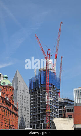 High rise residential Atlas building under construction with red cranes looming on the skyline in 2017  London N1 - Stock Photo
