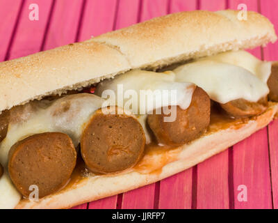Mozzarella Cheese and Meatball Bread Roll Against a Pink Background - Stock Photo