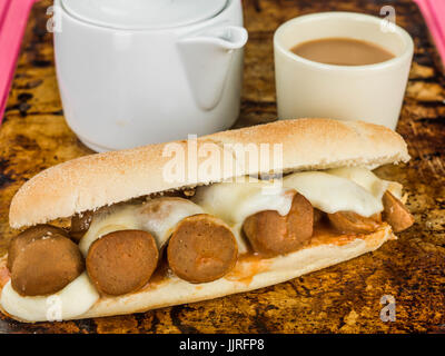 Mozzarella Cheese and Meatball Bread Roll On a Distressed Used Oven Tray - Stock Photo